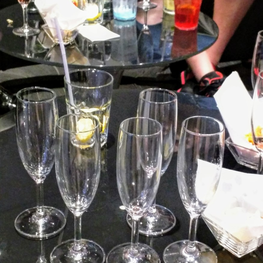 Empty Glasses Ignored in Champagne Bar
