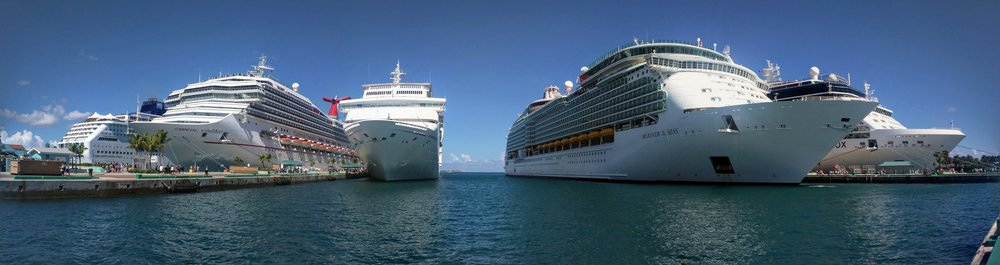 Celebrity Equinox in port with other ships.