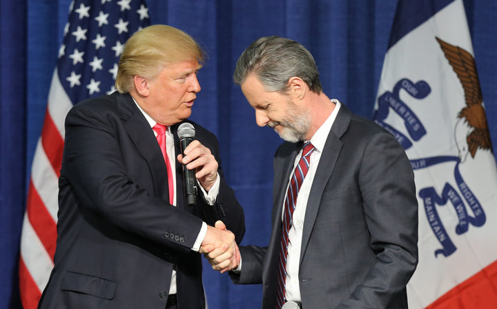 (Scott Morgan/Reuters: Then presidential candidate Donald Trump shakes hands with Jerry Falwell, Jr., president of Liberty University.)