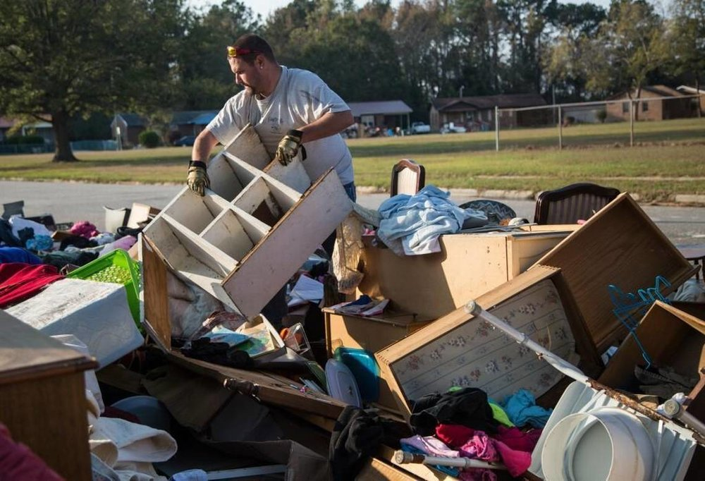 A Lumberton resident works to gut homes and remove debris after Hurricane Matthew. (Photo Credit Unknown)