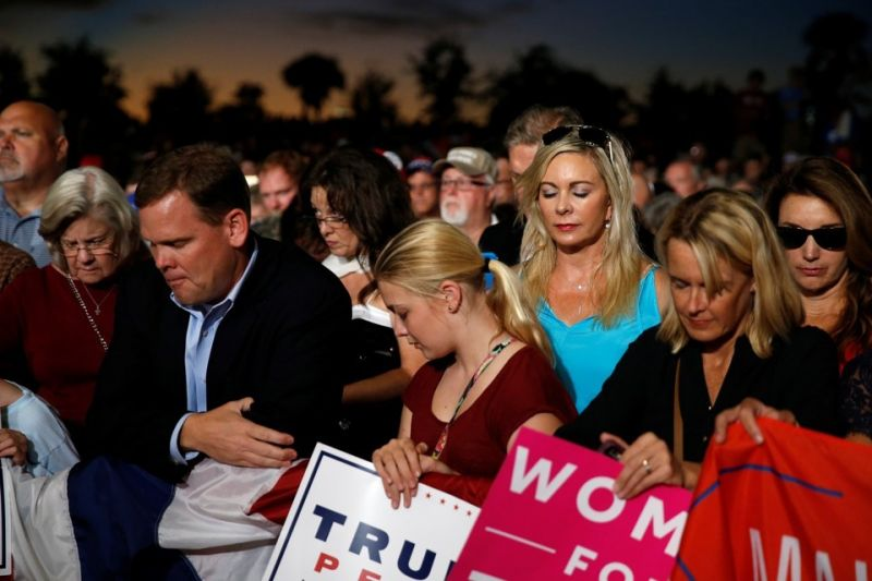 (Carlo Allegri/REUTERS) White evangelicals pray at a Trump rally in Florida.