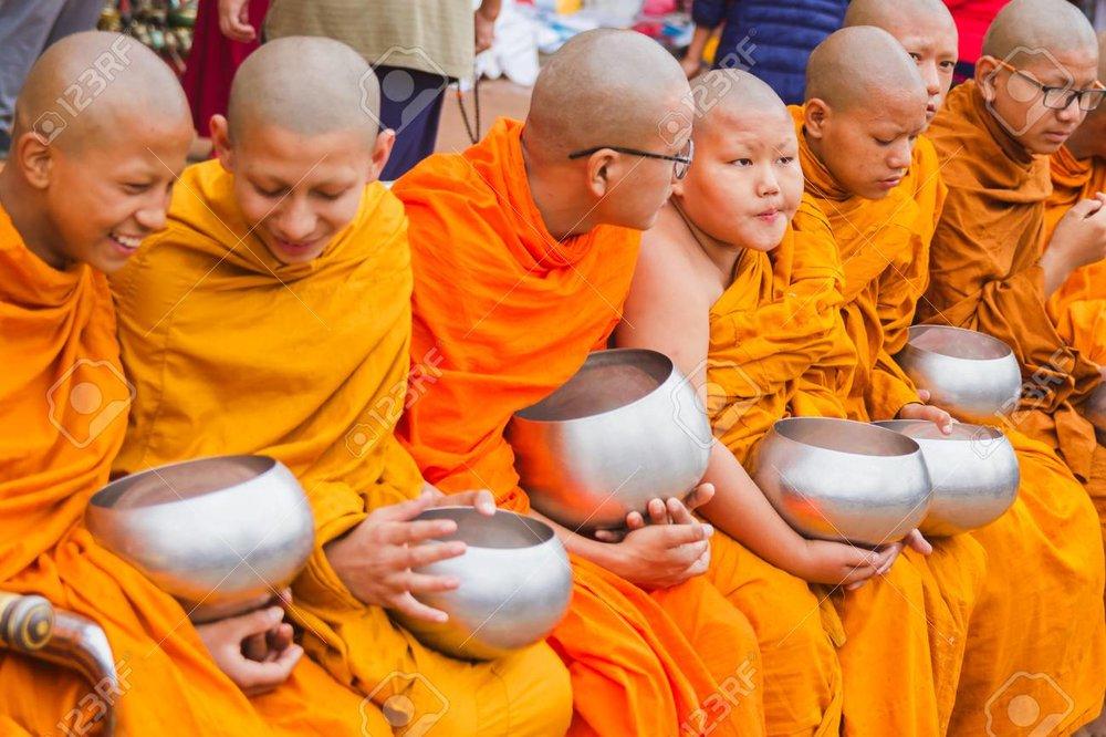 107119915-kathmandu-nepal-may-10-2017-group-of-buddhist-monks-collecting-alms-on-the-occassion-of-buddha-jayan.jpg