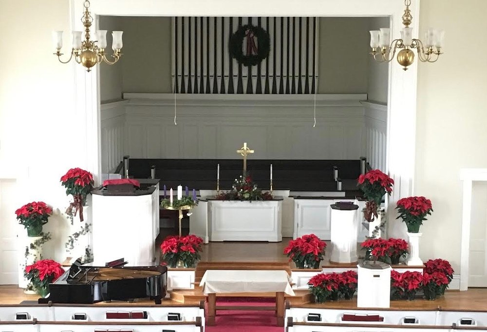 The sanctuary of Salem Presbyterian Church with pulpit, communion table, and font.