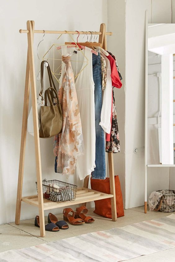 1. Clothing Rack - One simple solution is the addition of a clothing rack. While you may not want to display your clothing at all times in your room, a clothing rack can provide expansive hanging space you've never had before! And it can give you a chance to display your trendiest pieces as part of your decor!