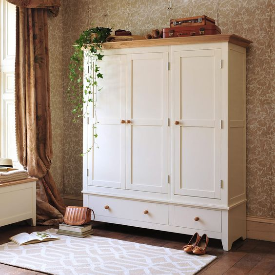 2. Wardrobe - If displaying your clothing is a little discomforting to you, try a wardrobe! Find one that matches your decor and there you have it. Adding a wardrobe can provide you with increased hanging space, as well as drawer space!