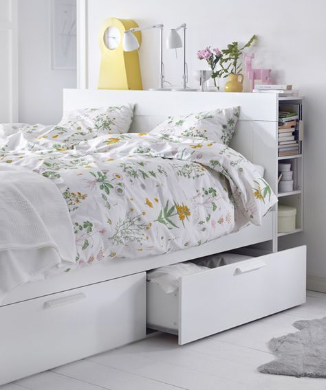 3. Use Your Bed Frame - If you're looking to add some storage to your room, you may want to purchase a bed that has built in storage! Some beds come with shelving built underneath or in the headboard. This space is discreet and stylish and can solve many of your storage problems!