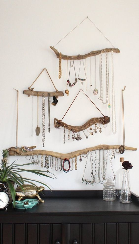 6. Hang Accessories - Accessories can take up a lot of space. Scarves, jewelry, and purses all need a place to go! Hang hooks on your wall for necklaces, handbags, or whatever accessories you have!