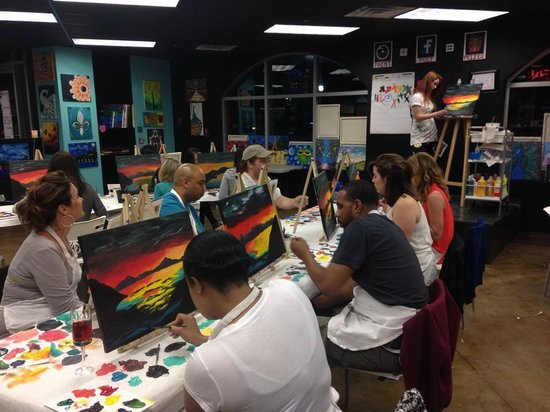 6. Uptown Art - If you're looking to be a little #Artsy, head to Jupiter's Uptown Art where you can paint with each other while enjoying some food and drinks. Channel your inner Picasso and get instruction from a local artist with your partner by your side.