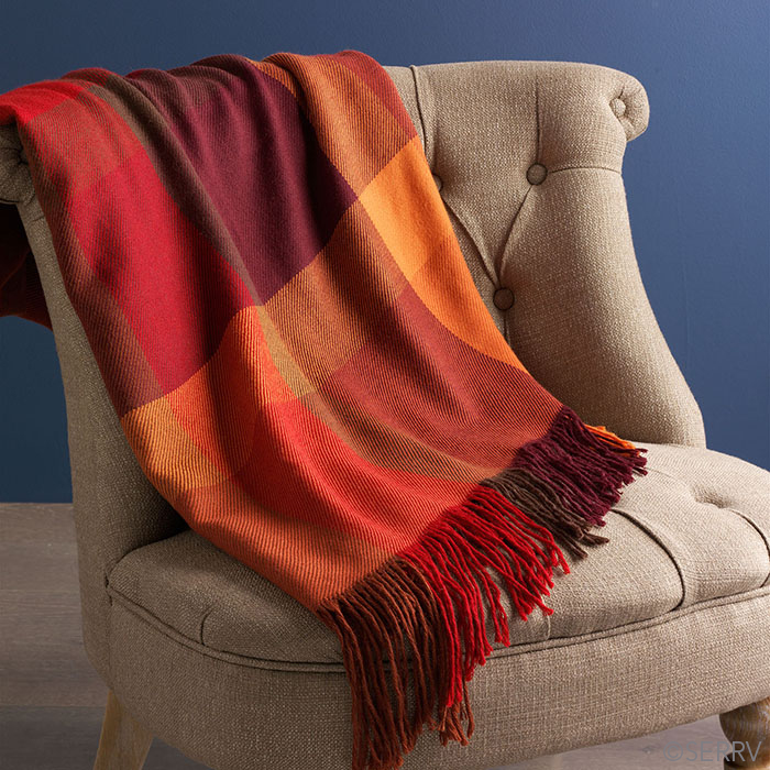 3. Warm Throws - Ahhh finally the time to bring out those warm throw blankets that are perfect for cuddling on the couch! Try a rich, warm color for the fall season!