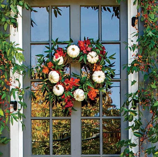 1. Window Wreath - What better way to show your neighbors and guests your autumn spirit than an awesome window wreath! Make one yourself for a personal touch or buy one if creativity isn't your thing.