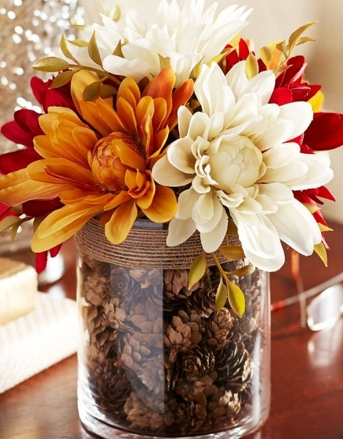 4. Creative Centerpiece - Get your #Autumn on by adding a beautiful Pinterest worthy centerpiece to your dining room! Use flowers, pinecones, pumpkins, or any warm colored objects to give your dining space a fall makeover!