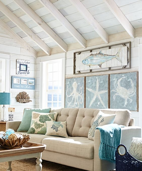 5. Beach Art - So you've added seashells, boats, palm trees, and blue and white elements to your home. What's next? Finish off your beach house look by going all out with beach art!Wooden signs, painted canvases, and photographs with the beach theme should live on the walls of your home!