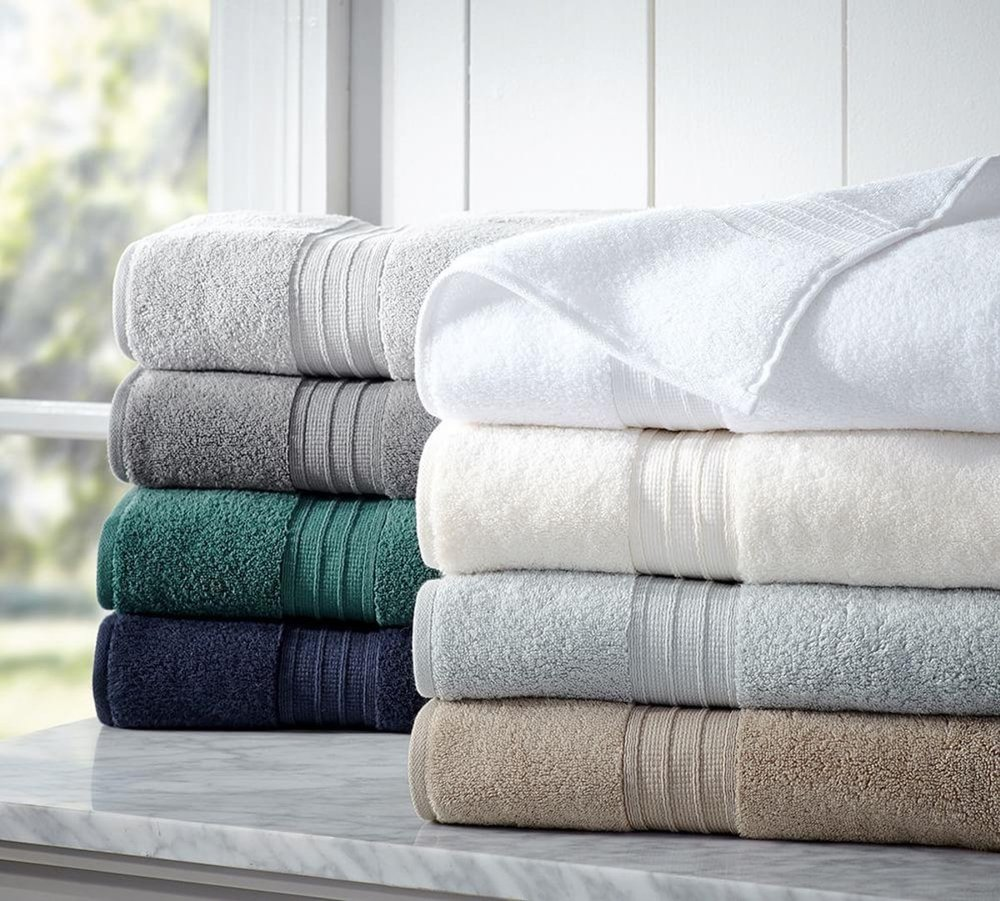 1. Luxe Linens - The easiest way to give your guest bathroom a new look is by adding luxurious linens. High quality towels will leave a good impression and make your guests feel more welcomed! No one likes using an old towel!image via potterybarn.com