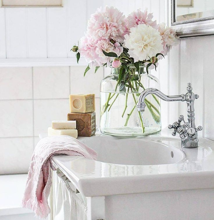 3. Beautiful Blooms - You will not believe the difference some added greenery or flowers can make in your guest bathroom! Check out your favorite local home decor store for some elegant or trendy vases, pop in some fresh or fake flowers and there you have it! This will give your bathroom a fresh and inviting feel!image via thikwebdesign.com