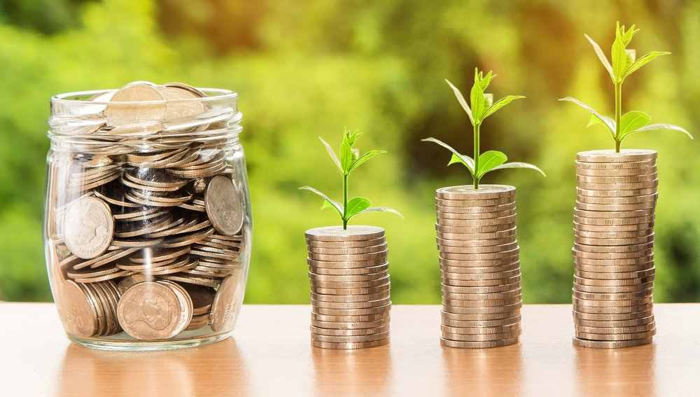 Plants growing from coins - growing resources