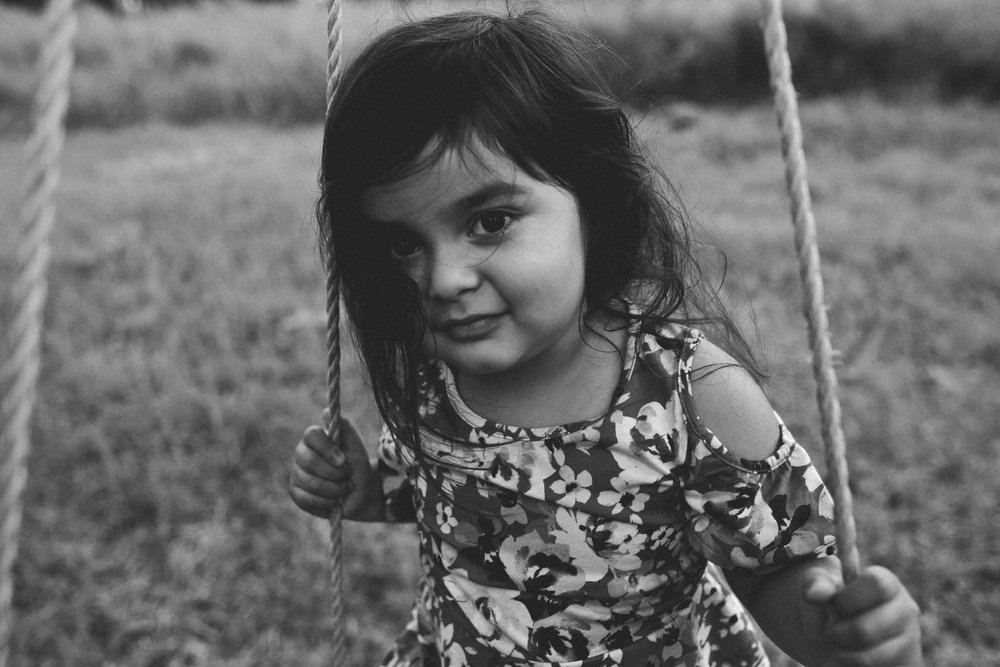 girl-on-tire-swing-hamilton-family-photographer-moody.jpg