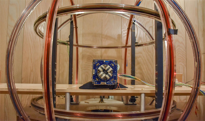 Helmholtz coil in a magnetically clean chamber, used to calibrate and test the magnetoresistive magnetometer.