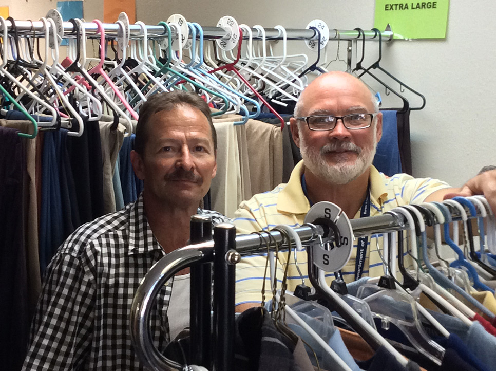 "DHT Operations Manager Chris Mays, right, and a recently released inmate ""go shopping"" in our donated clothing racks."