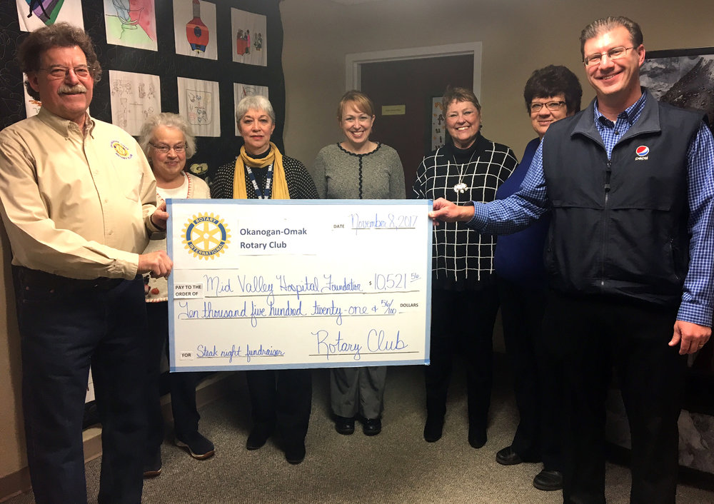 Rotary presents a check to the Foundation after a fundraiser brought in $10,521.