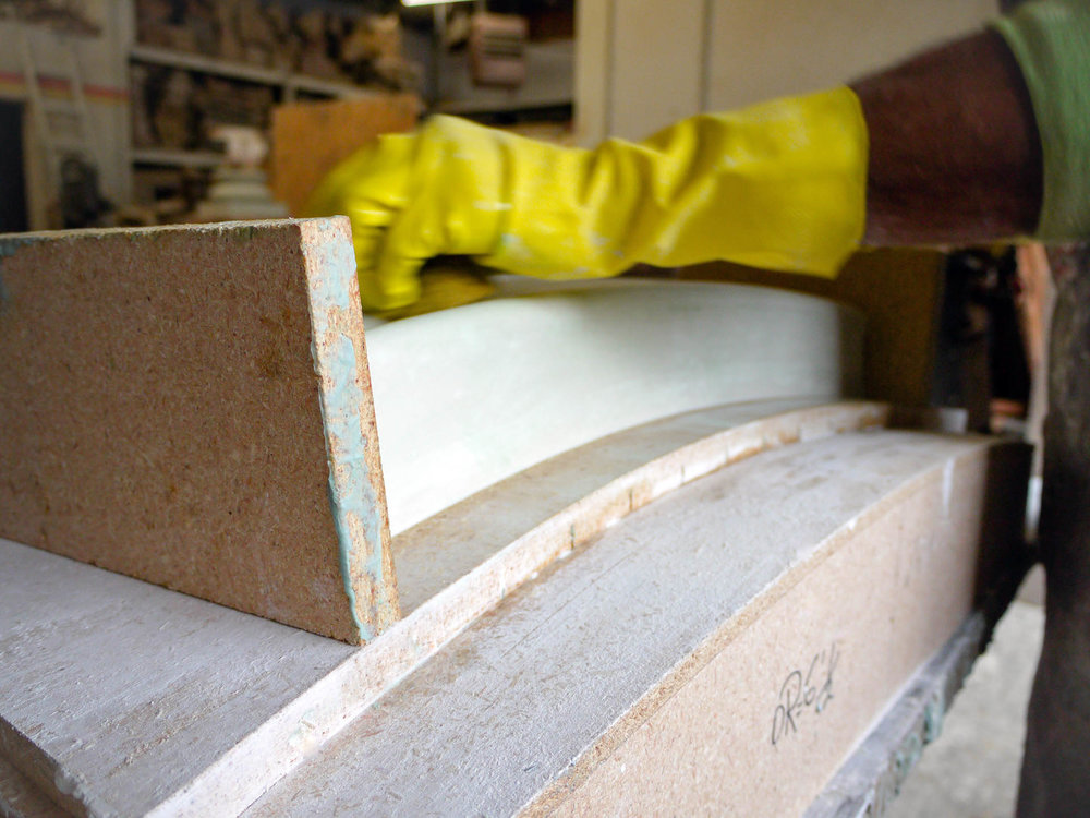 Ravacast team member works on a custom mold for a Window Sill.