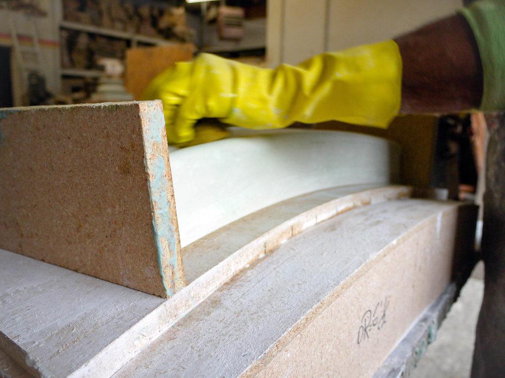 Ravacast team member works on a custom mold for a Window Sill.