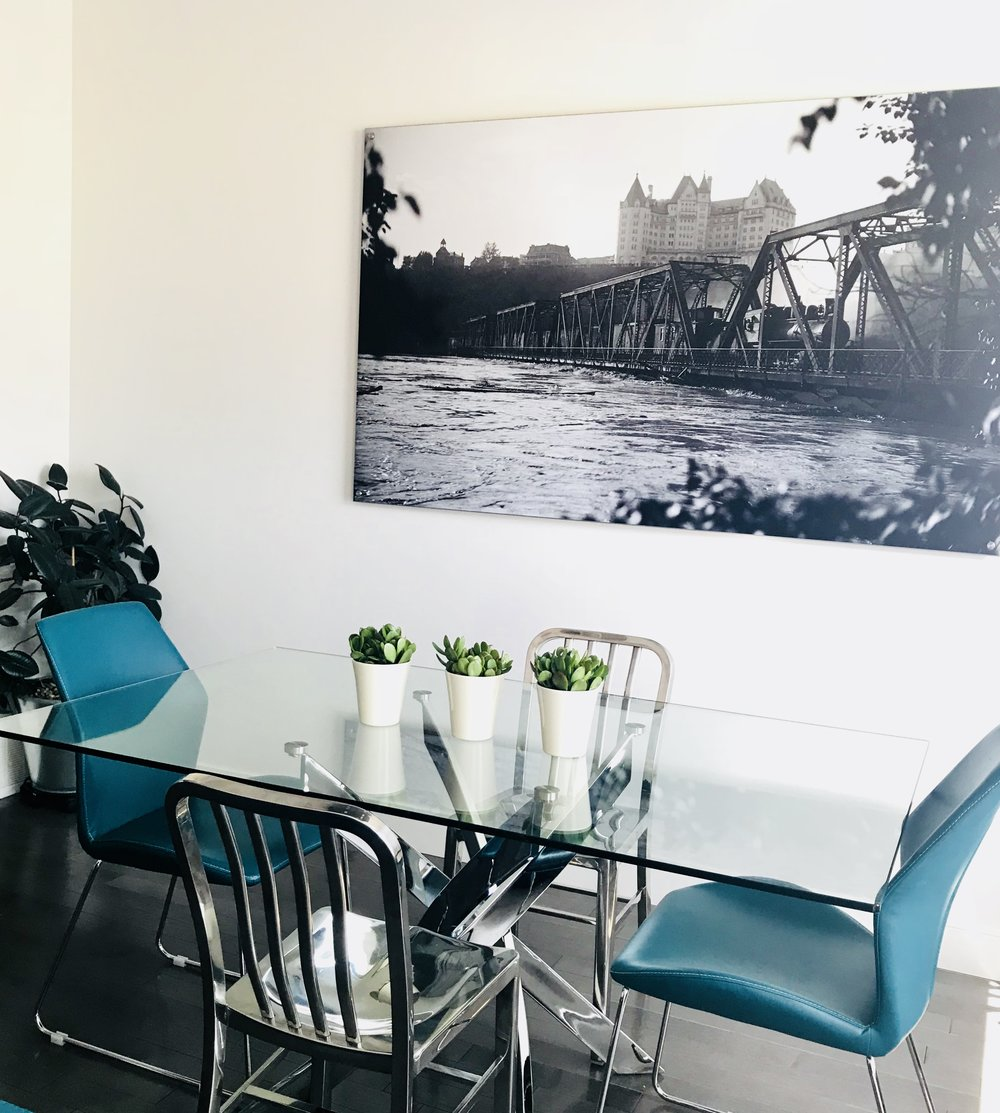 Modern-Minimal-Living Room Design-Glass Dining Table-Black and White Photography-Money Plants-Dining Table Accessories-Style Maven Decor-Edmonton Canada