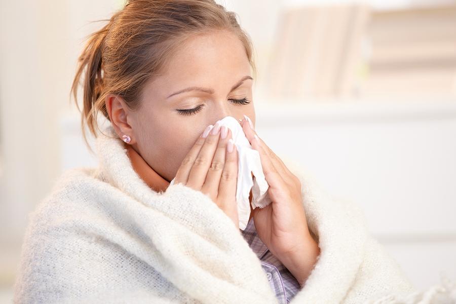 bigstock-Young-Woman-Having-Flu-Blowing-10620899.jpg