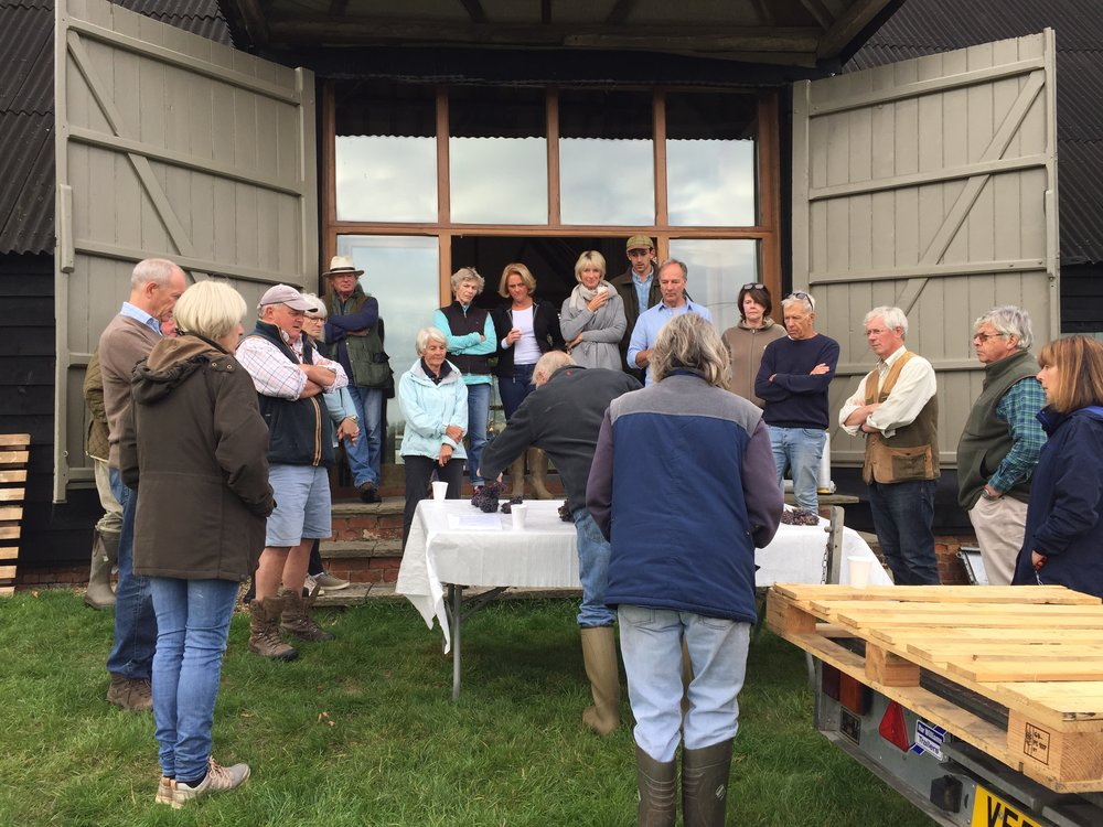 Quality standards. Robert sets out his stall with samples of grape bunches with disease that must not go in the crate. 'A drop of sour milk can ruin a cup of tea'. The experienced ones have heard it before but the 'new bugs' listen attentively.
