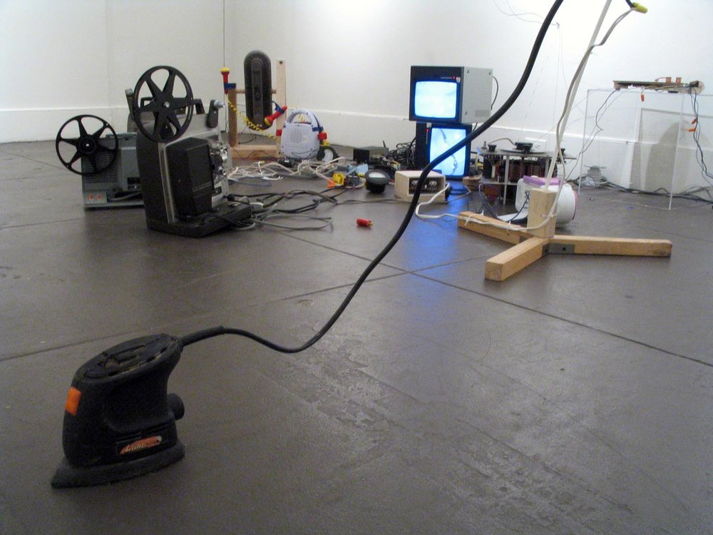 A free-range power sander that vibrates its way across the floor in response to changes in the noise level in the room.