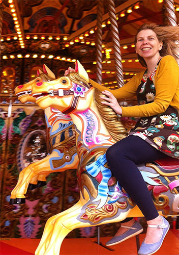 Me riding the carousel on Brighton Pier. I love colourful vintage style dresses.
