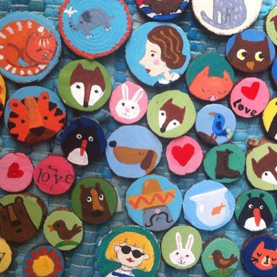 Selection of hand painted badges