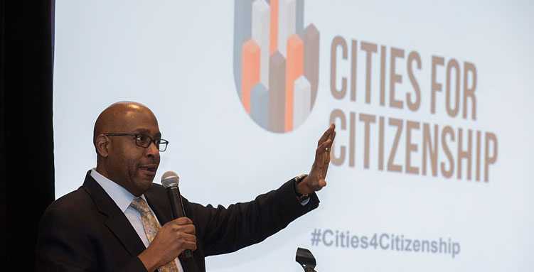 Chair of Arlington County Board, Christian Dorsey, welcomes attendees at the Cities for Citizenship (C4C) Municipal Gathering, and announces that Arlington County will join the C4C network. Photo: Carolina Kroon