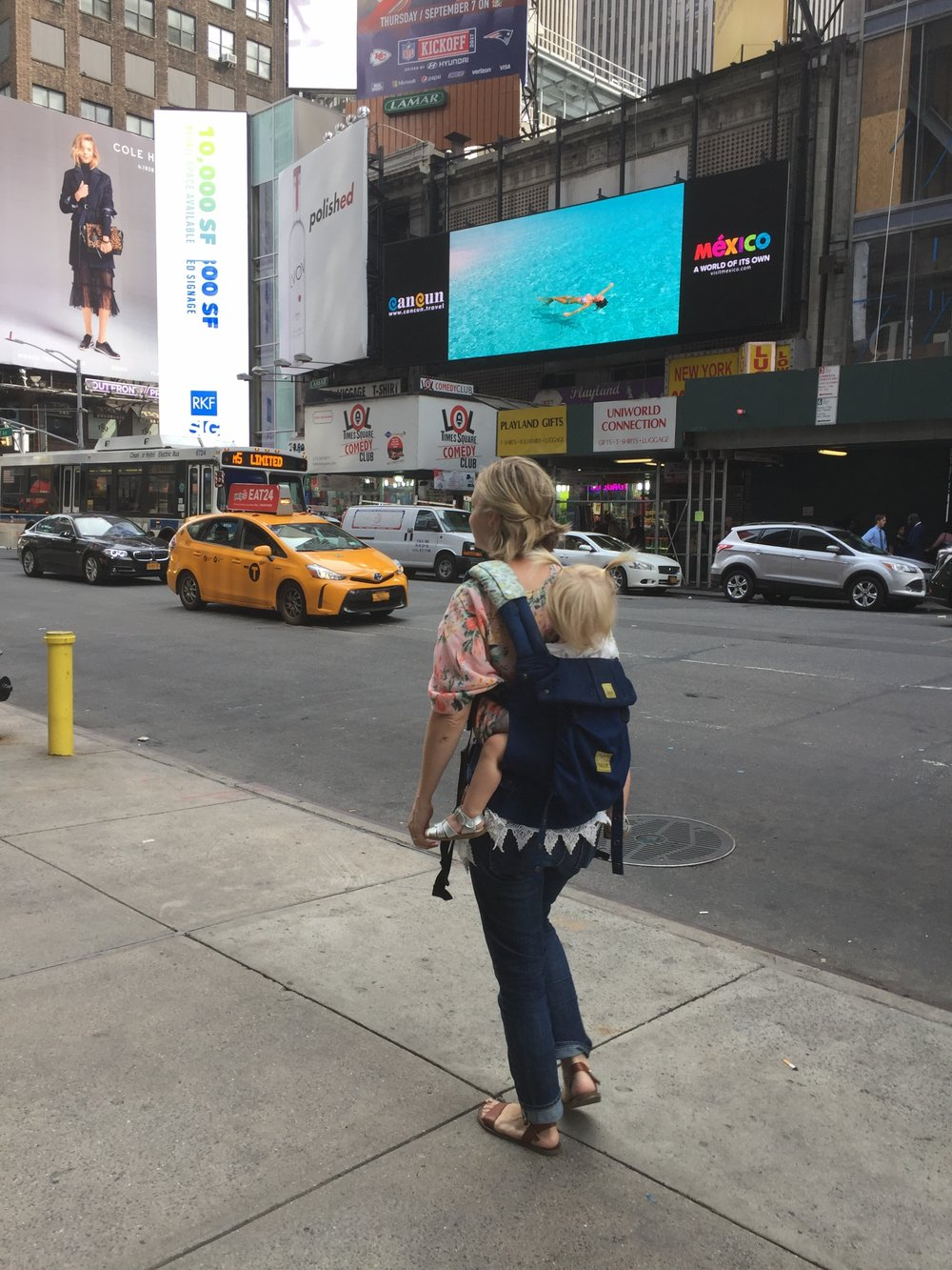 Baby wearing in our Lille Baby carrier in Time Square! Elizabeth loved being carried.