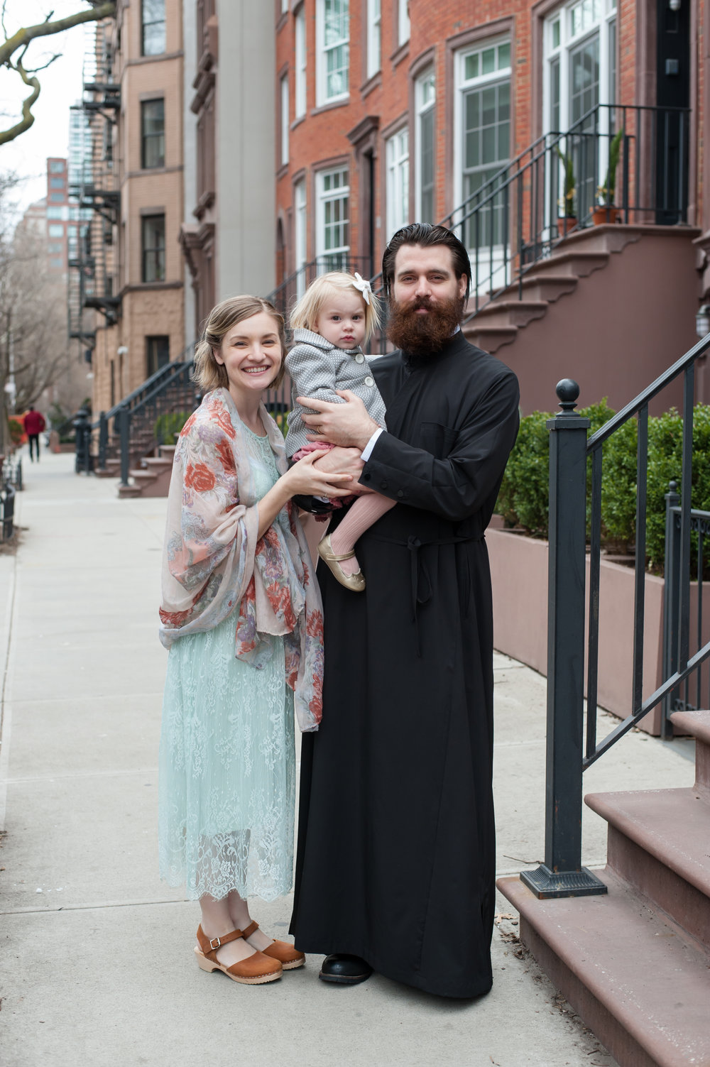 "Our little family! My husband wears a black cassock as his seminary ""uniform"" and on Sundays since he is a sub-deacon. Photo credit  Alexis El Massih Photography"