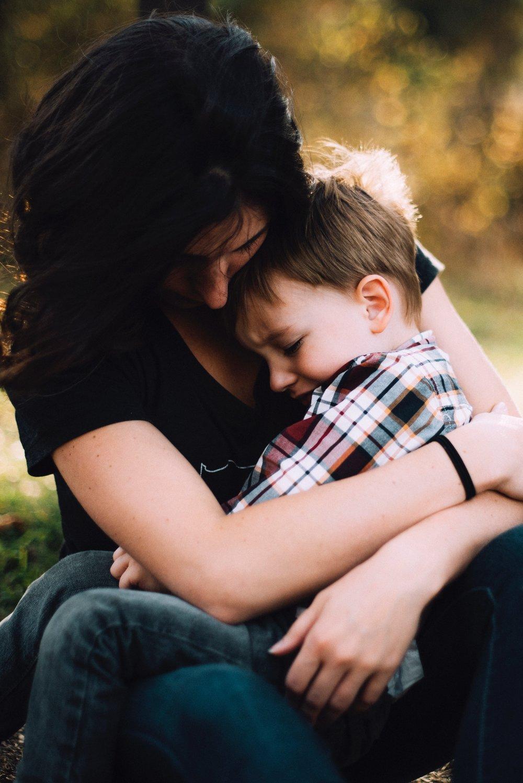 Photo of mother holding upset child