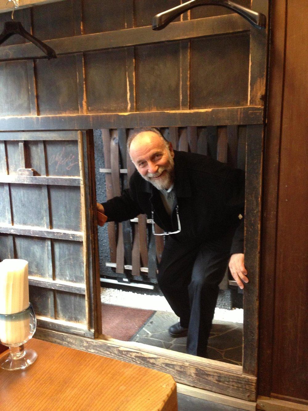 Ben entering an old small security entrance.jpg