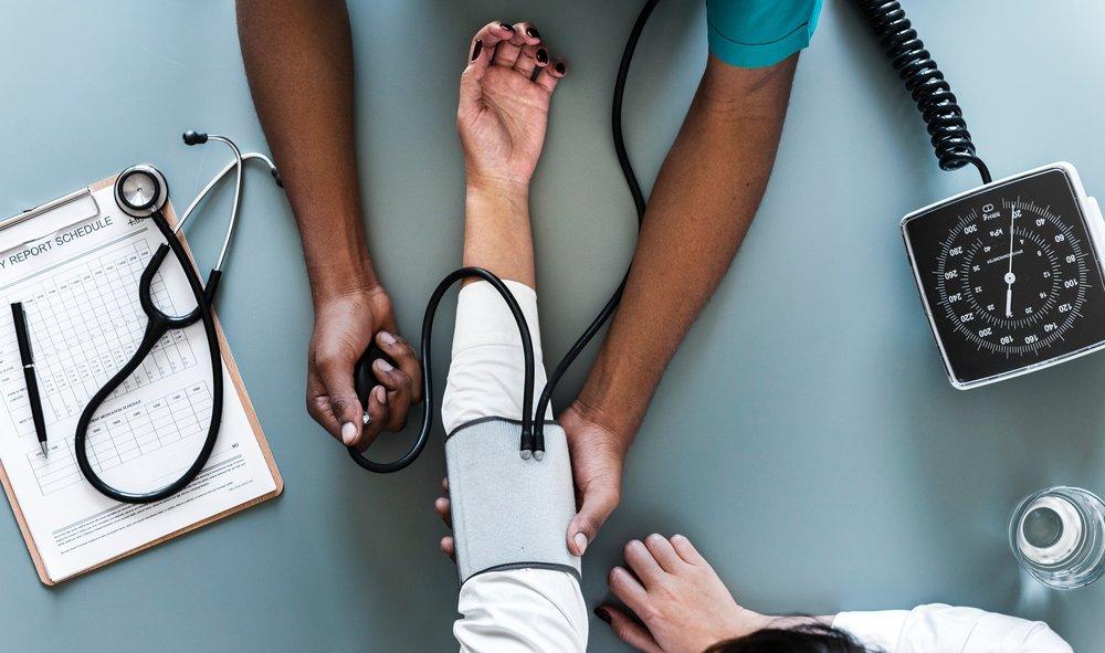 nurse taking patient's blood pressure image