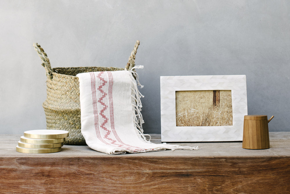 A California Fall :   : Brass Edged Marble Coasters :: an Ethiopian Cotton Hand Towel :: Handwoven Seagrass Belly Basket :: Bone Inlay Herringbone Frame :: Teak Salt Cellar with Lid & Spoon
