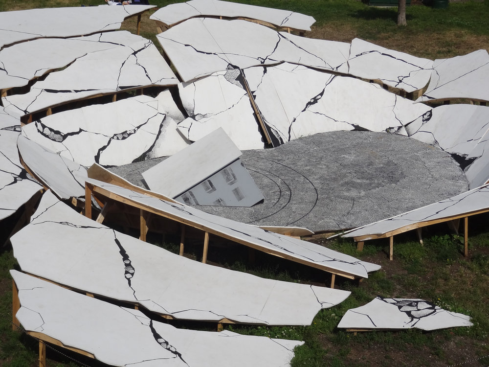 Suspect Terrain , 2014-2015, Painted wood, 50 feet across   A large scale public sculpture derived from photo documentation of historical instances of sinkholes.