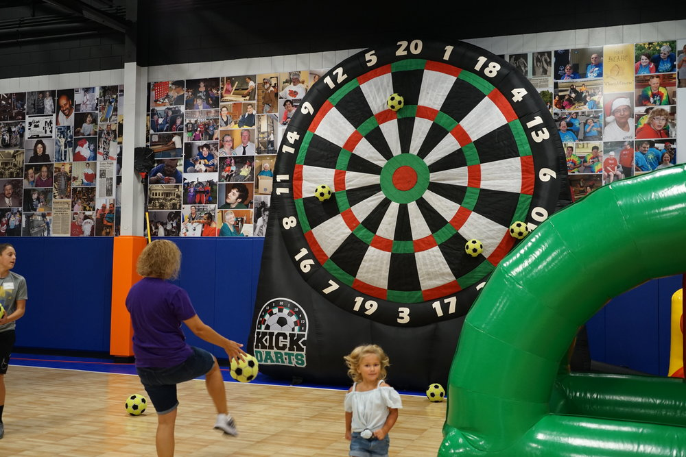 Foot Darts - Show off your target skills by kicking the ball and aiming for the bulls-eye.