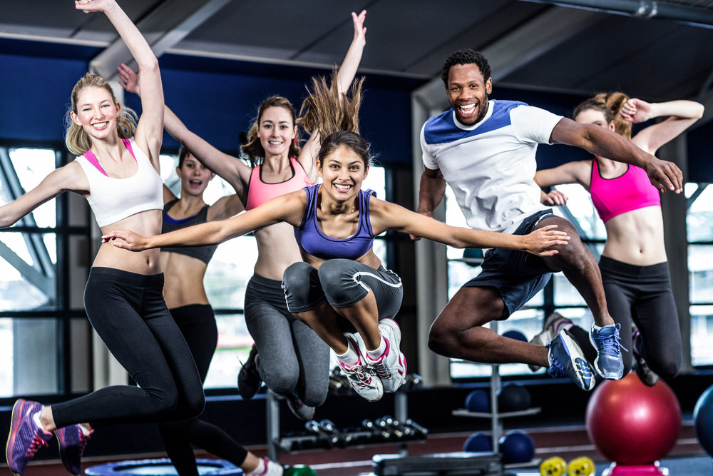 Fit-group-smiling-and-jumping-668100468_5760x3840.jpeg