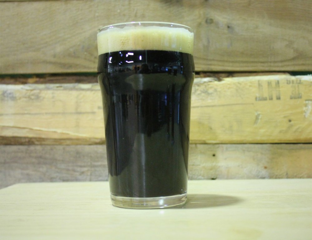 Island Night Stout - We love stouts and with this one we bend the rules. We took characteristics of stouts we loved and made a hybrid. We wanted it dry with a lighter profile. We also wanted a clean fermentation, so we used a lager yeast and fermented it cold to let the malts shine through. Taste it cold and then again when it warms up for a spectrum of stout flavors. It is sessionable so you can have more than one.4.6% ABV