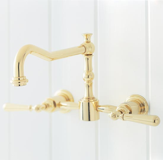 Polished brass pillar style wallmounted kitchen faucet
