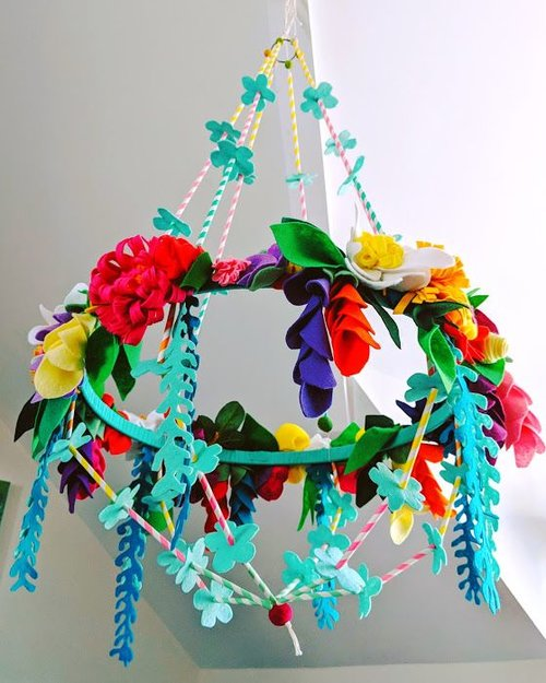 Pajaki Inspired Felt Flower Chandelier - The Pajaki Chandelier is traditionally made from paper straws and paper pompoms, made in Poland by families during the holidays. They are hung through the winter to protect the home with good luck and good health. Using this vibrant, beautiful tradition, we invite you to make your own felt flower chandelier. Give it as a gift for someone who has moved into their first home, make one for a garden party, or reinvigorate and bring some sunshine colours into your home, this workshop will give you the essential skills to make your own good luck, good health chandelier.Using felt, wire and straws you will be given step-by-step instructions to create your own vibrant felt flower chandelier. If you have a specific colour palette in mind (maybe you need all pinks and yellows - to fit with a bedroom or lounge colour scheme) …. Just let us know and we'll make such we have the felt colours in just for you!Cost: 5 hours £70