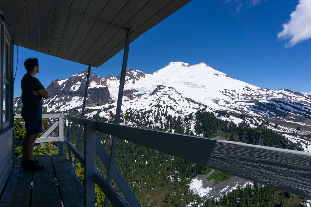 "I hiked up to this fire lookout tower with this great view of Mt. Baker… - It was a pretty tough hike, 8 miles, up the whole time, lots of trudging through slush and snow.I was the first one up there for the day, so I had a snack and started reading a book for a bit.Another older gentlemen showed up. We got to chatting about how beautiful this spot was and I said ""it's a great place to relax and do some reading"".And he said ""Yep. Or not. Or just BE.""And I sat there and thought about that for a minute. And I liked that idea of just ""being"".So I put the book down for a bit and just ""was"".I'm really bad about being mindful of living in the moment. Something I'm going to work on more over this trip. Thanks for the reminder, Dave."