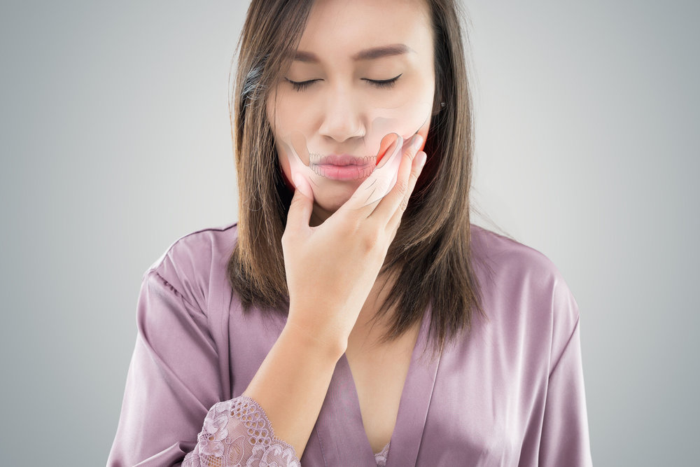 How Chiropractic Temporormandibular Joint (TMJ) Adjustment and Low Level Laser Therapy Are Effective Treatments for the Pain and Discomfort of TMJ/TMD