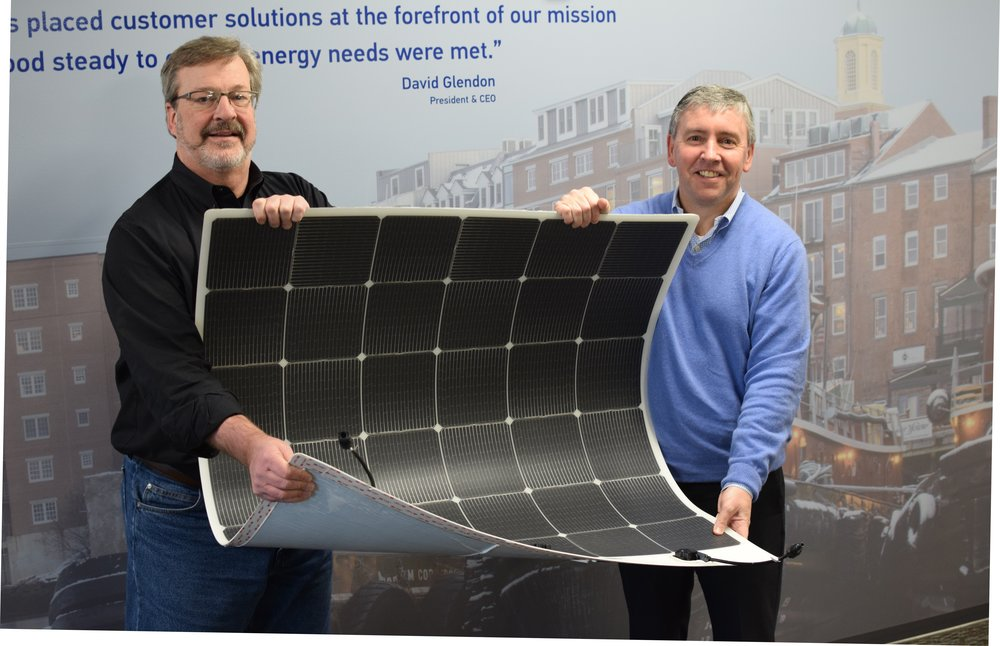 Kevin Maloney of Picktricity and David Glendon of Sprague show thin and flexible solar panel applied to Sprague tank.