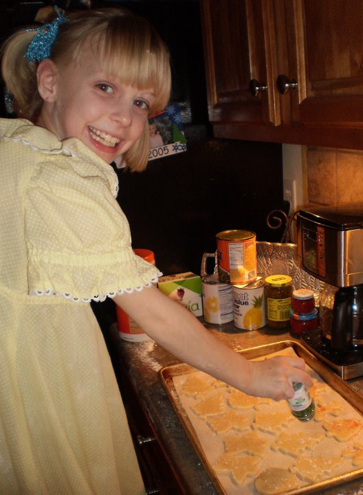 My Sweet Rae, several years ago, making Christmas cookies, all dressed up!