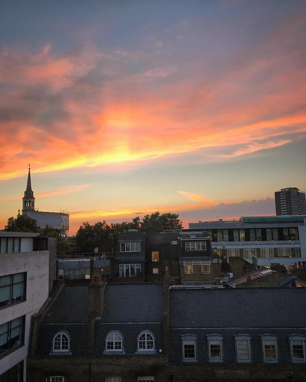 Sunset over Clerkenwell.  The city echoed with alternating groans and cheers from spectators spilling out from packed bars watching their fellow Englishmen play Columbia in the World Cup quarterfinals.  When the UK won, the whole city seemingly erupted into screams and songs and horns.  -  #england #london #worldcupmadness  (at London, United Kingdom)