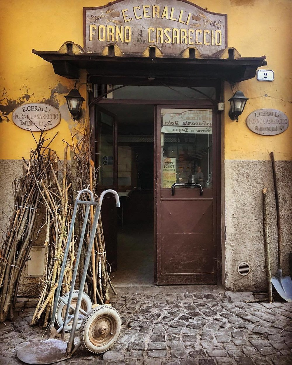 Bundles of chestnut and cherry tree prunings awaiting their turn to fire up a bread oven for a fast and furious heat.    -  #italy #tuscany #frascati #woodoven #bread #breadislife  (at Frascati, Italy)